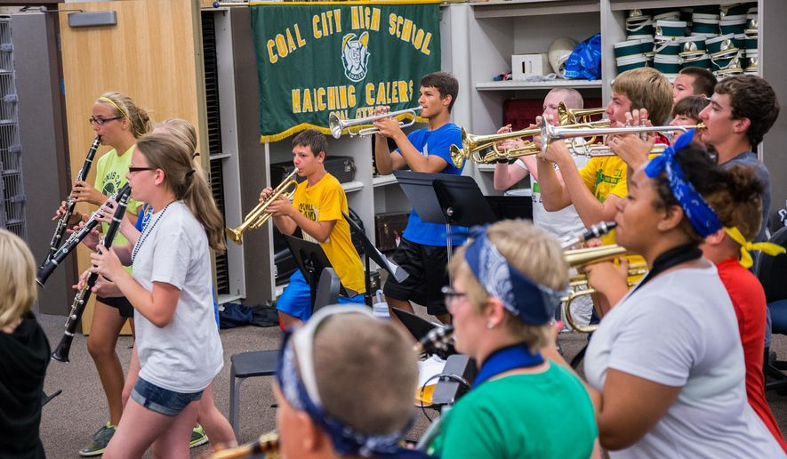 Students with Coal City High School marching band practice for opening day at the school in Coal City, Ill., Thursday, Aug. 6, 2015. The new school year starts Aug. 14 and about 282 students who are still displaced from their homes. (Zbigniew Bzdak/Chicago Tribune via AP) MANDATORY CREDIT, CHICAGO SUN-TIMES OUT, DAILY HERALD OUT, NORTHWEST HERALD OUT, DAILY CHRONICLE OUT, THE HERALD-NEWS OUT, THE TIMES OF NORTHWEST INDIANA OUT, TV OUT, MAGS OUT, NO SALES