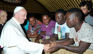 Pope Francis salutes migrants from Nigeria during his weekly general audience he held in the Pope Paul VI hall, at the Vatican,  Wednesday, Aug. 12, 2015. (L'Osservatore Romano/Pool Photo via AP)