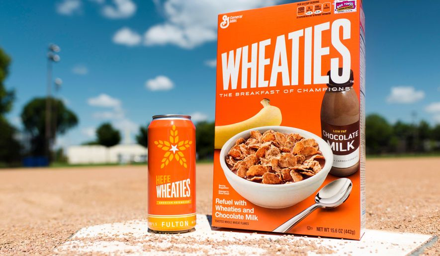 This undated photo provided by General Mills shows a box of Wheaties cereal next to a can of limited-edition HefeWheaties beer. Wheaties said it is partnering with a craft brewery to make the beer. (General Mills via AP)