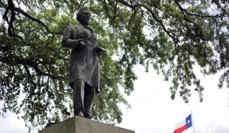 In this May 5, 2015, file photo, a statue of Jefferson Davis is seen on the University of Texas campus in Austin, Texas. The president of the University of Texas has ordered removing the statue of Davis from the center of campus, but statues of other Confederate figures will stay. The Davis statue has been targeted by vandals and had come under increasing criticism. (AP Photo/Eric Gay, file)
