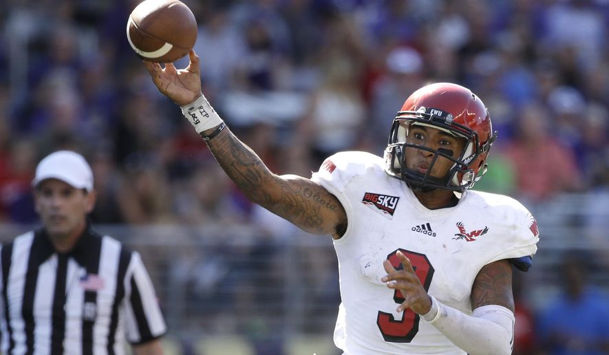 FILE - In this Sept. 6, 2014, file photo, Eastern Washington quarterback Vernon Adams Jr. throws a pass against Washington Huskies in the second half of an NCAA college football game  in Seattle. Oregon awaited word Thursday, Aug. 13, 2015, whether transfer Vernon Adams had passed his final class so he can join the Ducks. The star quarterback, who intends to play at Oregon for his final season of eligibility, needed to complete the coursework required by Eastern Washington to transfer. NCAA rules allow players who have graduated to transfer to another school without having to sit out a season.  (AP Photo/Elaine Thompson, File)
