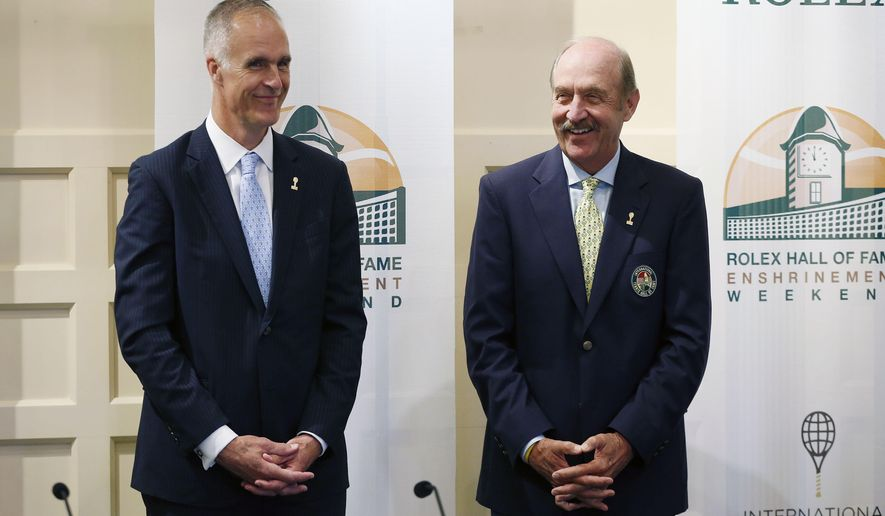 FILE - In this July 18, 2015, file photo, International Tennis Hall of Fame CEO Todd Martin, left, and president Stan Smith stand together before a news conference introducing the 2015 inductees to International Tennis Hall of Fame in Newport, R.I. Martin, the organization's new executive director, said he wants the Hall of Fame to become world-renowned and live up to its international title. (AP Photo/Michael Dwyer, File)