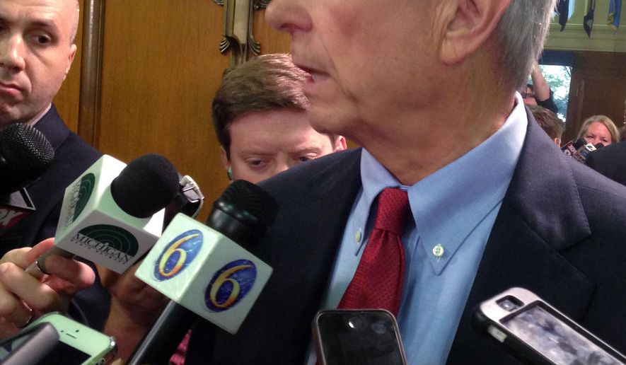 Michigan Public Service Commission member Norm Saari, former top aide to Republican House Speaker Kevin Cotter, answers reporters' questions after a Senate advice-and-consent hearing on Thursday, August 13, 2015 in Lansing, Mich. Democrats say Saari ignored whether Reps. Todd Courser of  Lapeer and Cindy Gamrat of Plainwell misused public funds in an attempt to hide their relationship. Saari told reporters he did nothing wrong and Cotter acted appropriately. (AP Photo/David Eggert)