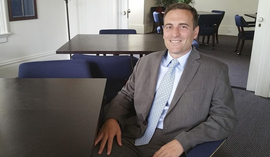 In this photo taken Aug. 7, 2015, Nevada Attorney General Adam Laxalt poses for a portrait in Carson City, Nev. Laxalt says he hopes his Basque-themed gathering of Republican presidential candidates this weekend will become a can't-miss campaign stop and spawn copycats in the Silver State. Laxalt is hosting the inaugural Basque Fry on Saturday at a ranch in Gardnerville. Republican presidential candidates Scott Walker, Ted Cruz, Carly Fiorina, Ben Carson and George Pataki are scheduled to attend. (AP Photo/Michelle Rindels)