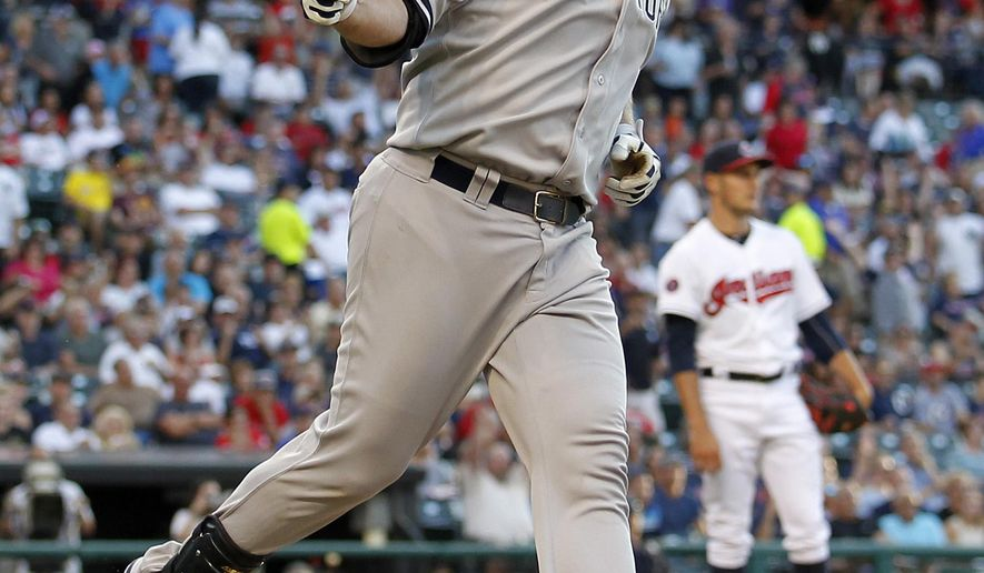 New York Yankees' Brian McCann points to the dugout after hitting a three-run home run in the first inning of a baseball game against the Cleveland Indians on Thursday, Aug. 13, 2015, in Cleveland. (AP Photo/Aaron Josefczyk)