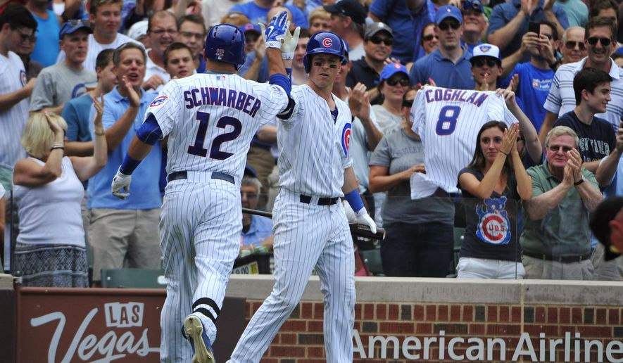 Chicago Cubs' Kyle Schwarber (12) is greeted by Chris Coghlan, right, after hitting a home run against the Milwaukee Brewers during the fifth inning of a baseball game, Thursday, Aug. 13, 2015, in Chicago. (AP Photo/David Banks)