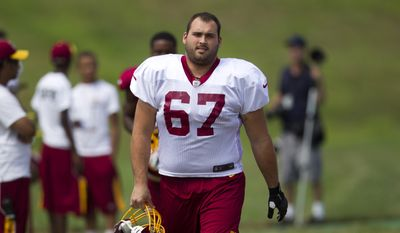 Washington Redskins guard Josh LeRibeus walks to the practice filed during the teams NFL football training camp practice on Monday, July 30, 2012 in Ashburn, Va. (AP Photo/Evan Vucci)