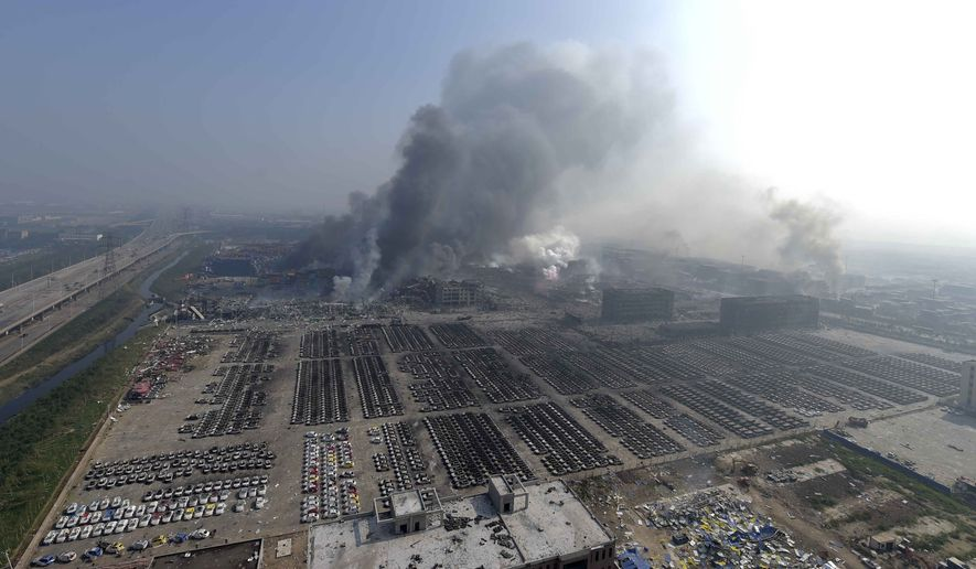 Huge explosions in the warehouse district of China's Tianjin municipality sent up massive fireballs that turned the night sky into day, officials and witnesses said. (Xinhua via AP)