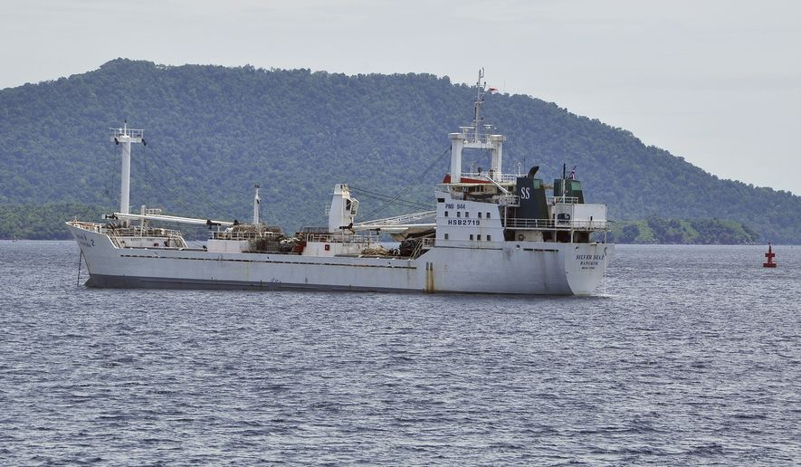 Thai-owned cargo ship Silver Sea 2 is anchored off an Indonesian Navy base in Sabang, Aceh province, Indonesia, Thursday, Aug. 13, 2015. A massive refrigerated cargo ship believed to be loaded with slave-caught fish was seized by Indonesia's navy and brought to shore after The Associated Press informed authorities that it had entered the country's waters, officials said Thursday. (AP Photo/Syahrul Rizal)