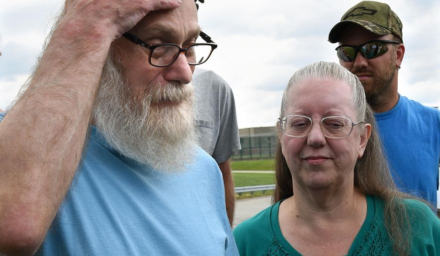 Lewis Fogle with his wife, Deb, becomes emotional after his release from the State Correctional Institution Thursday, Aug. 13, 2015, in Pine Grove, Pa. Fogle, who spent 34 years imprisoned for the 1976 murder of a 15-year-old girl, was released after DNA tests proved his was not the person who committed the crime. (Bob Donaldson/Pittsburgh Post-Gazette via AP) MAGS OUT; NO SALES; MONESSEN OUT; KITTANNING OUT; CONNELLSVILLE OUT; GREENSBURG OUT; TARENTUM OUT; NORTH HILLS NEWS RECORD OUT; BUTLER OUT; MANDATORY CREDIT