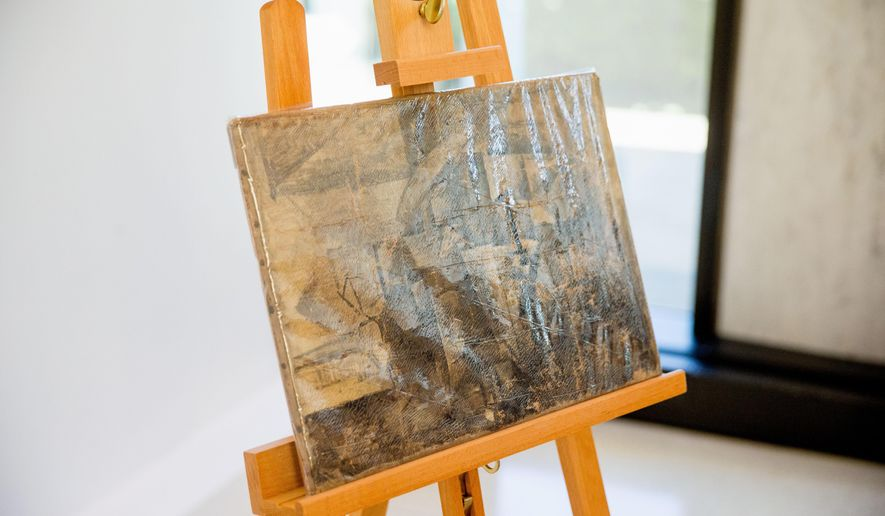 """Pablo Picasso's """"La Coiffeuse,"""" seen in a protective plastic cover, is displayed at the French Embassy in Washington, Thursday, Aug. 13, 2015. The U.S. Immigration and Customs Enforcement returned the stolen painting, valued at $15 million, that was stolen in 1998 and was seized in December 2014. (AP Photo/Andrew Harnik)"""