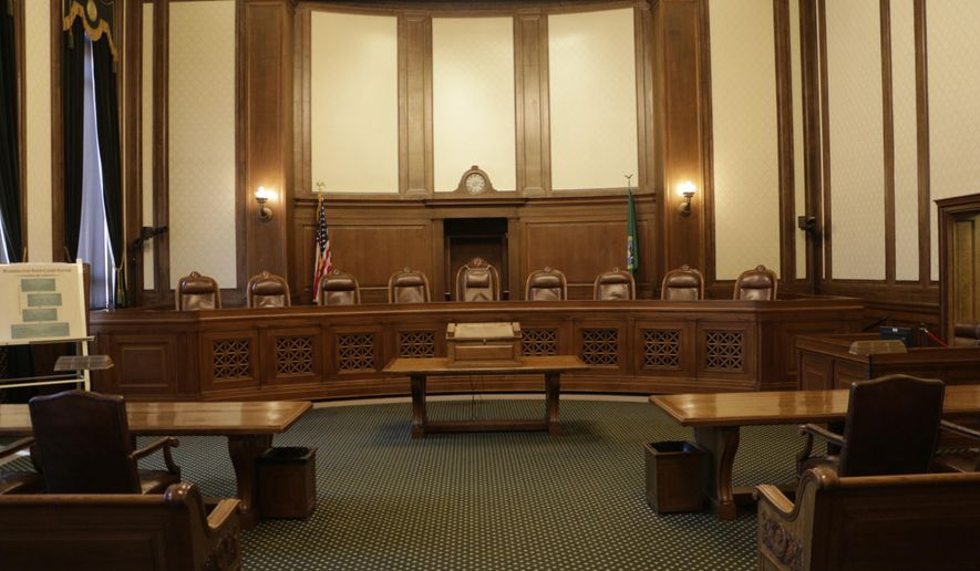 The chambers of the Washington state Supreme Court sit empty on Thursday, Aug. 13, 2015, in Olympia, Wash. The court has issued sanctions of $100,000 a day against the state for its lack of progress on a plan to full fund basic education. (AP Photo/Rachel La Corte)