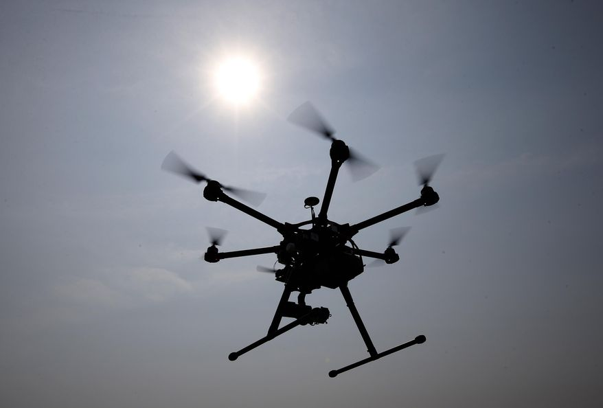 In this June 11, 2015, file photo, a hexacopter drone is flown in Cordova, Md. Pilot reports of drone sightings so far this year are more than double last year, the Federal Aviation Administration reported  recently. (AP Photo/Alex Brandon, File)