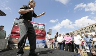 "Rick Perry gets into it with the grassroots audience at the Iowa State Fair ""soapbox"" in 2014. (AP Photo)"