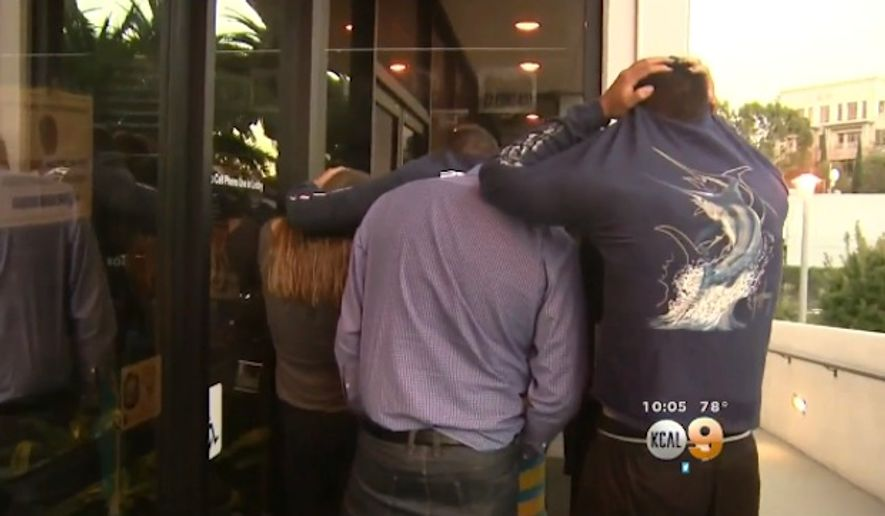 Four pranksters turned themselves into police Tuesday after revving a leaf blower and terrifying movie goers inside a California theater. (CBS Los Angeles)