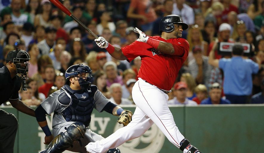 Boston Red Sox's Pablo Sandoval follows through on a two-run double as Seattle Mariners catcher Jesus Sucre looks on during the third inning of a baseball game at Fenway Park in Boston Friday, Aug. 14, 2015.(AP Photo/Winslow Townson)