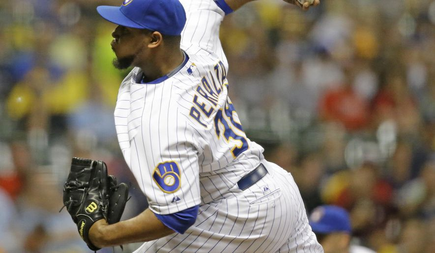 Milwaukee Brewers starting pitcher Wily Peralta throws to a batter during the first inning of a baseball game Friday, Aug. 14, 2015, in Milwaukee. (AP Photo/Jeffrey Phelps)
