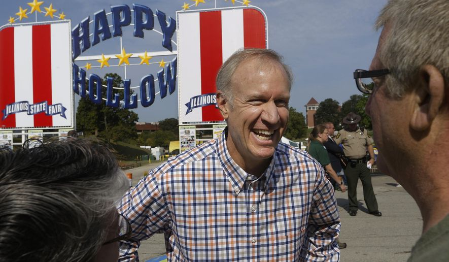 Illinois Gov. Bruce Rauner greets visitors to the Illinois State Fair on opening day Friday, Aug. 14, 2015, in Springfield, Ill. The Illinois State Fair will run from Aug. 14, throughout Aug. 23. (AP Photo/Seth Perlman)