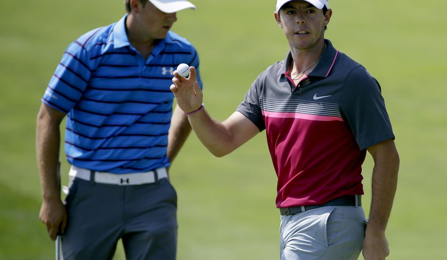 Rory McIlroy, of Northern Ireland, reacts in front of Jordan Spieth, left, after McIlloy made a birdie putt on the sixth hole during the second round of the PGA Championship golf tournament Friday, Aug. 14, 2015, at Whistling Straits in Haven, Wis. (AP Photo/Brynn Anderson)