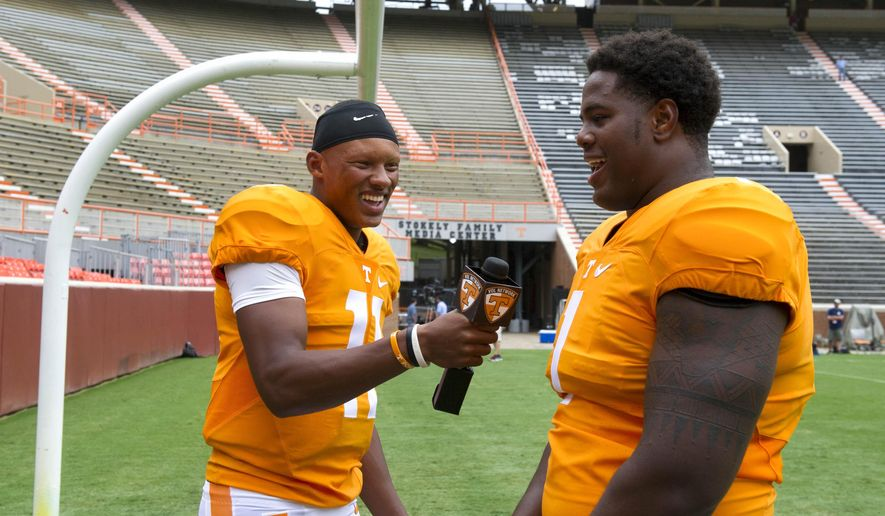 Tennessee quarterback Joshua Dobbs, left, interviews defensive lineman Kahlil McKenzie during media day Friday, Aug. 14, 2015, in Knoxville, Tenn. (Jessica Tezak/Knoxville News Sentinel, via AP) MANDATORY CREDIT