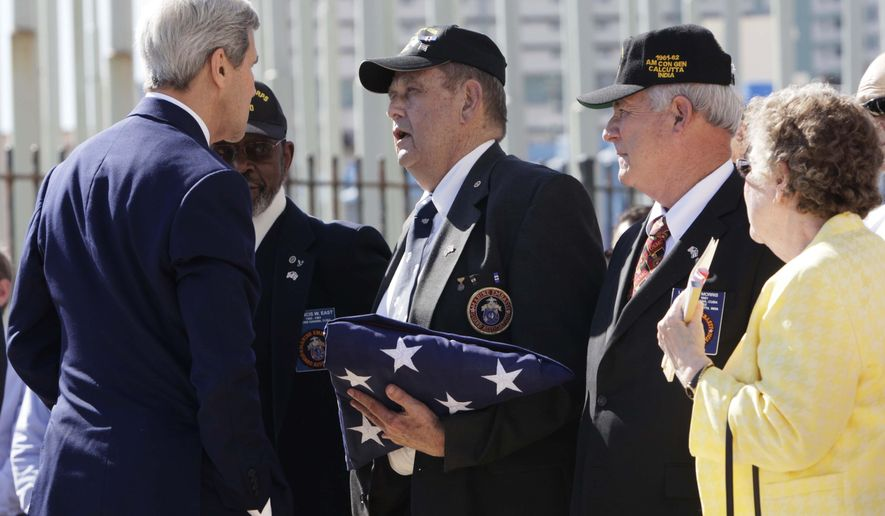 "U.S. Secretary of State John Kerry greets the three Marines who lowered the flag at the U.S. Embassy's closing in 1961, Francis 'Mike' East, from left, James Tracy, and Larry Morris, at the flag raising ceremony of the newly opened embassy, in Havana, Cuba, Friday, Aug. 14, 2015. Three U.S. Marines who lowered the flag at the U.S. Embassy in Havana over five decades ago were back in Cuba on Friday to see the stars and stripes raised once again.  The three veterans received a standing ovation at the seaside diplomatic mission as they handed a folded flag to three active Marines, who raised it to a brass band rendition of ""The Star-Spangled Banner.""(AP Photo/Ismael Francisco, Cubadebate)"