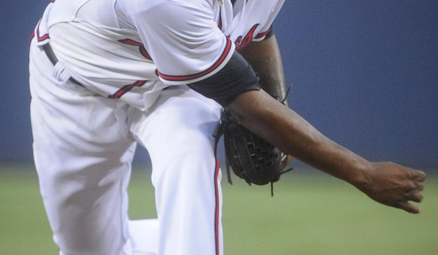 Atlanta Braves' Julio Teheran works against the Arizona Diamondbacks during the first inning of a baseball game, Friday, August 14, 2015, in Atlanta. (AP Photo/John Amis)