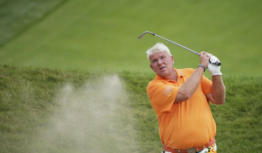 John Daly hits out of a bunker on the 18th hole during the second round of the PGA Championship golf tournament Friday, Aug. 14, 2015, at Whistling Straits in Haven, Wis. (AP Photo/Chris Carlson)