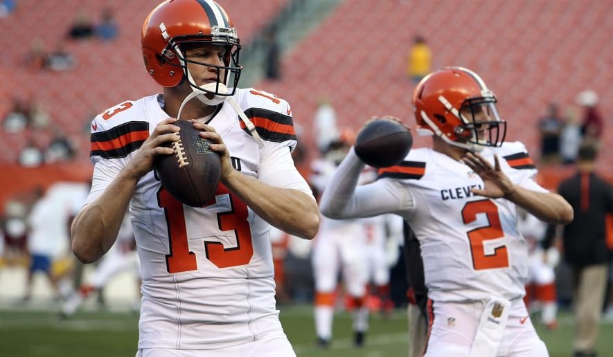 In this Thursday, Aug. 13, 2015 photo, Cleveland Browns quarterbacks Josh McCown (13) and Johnny Manziel (2) warm up before an NFL preseason football game between the Browns and the Washington Redskins in Cleveland. McCown doesn't view Manziel as a threat, but as a teammate to teach. The veteran quarterback was signed by Cleveland to stabilize the position and help Manziel following his turbulent rookie season. So far, the plan has been flawless. (AP Photo/Ron Schwane)