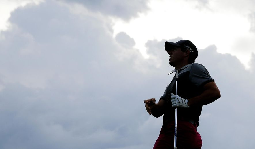 Rory McIlroy, of Northern Ireland, watches a shot on the 15th hole during the first round of the PGA Championship golf tournament Thursday, Aug. 13, 2015, at Whistling Straits in Haven, Wis. (AP Photo/Jae Hong)