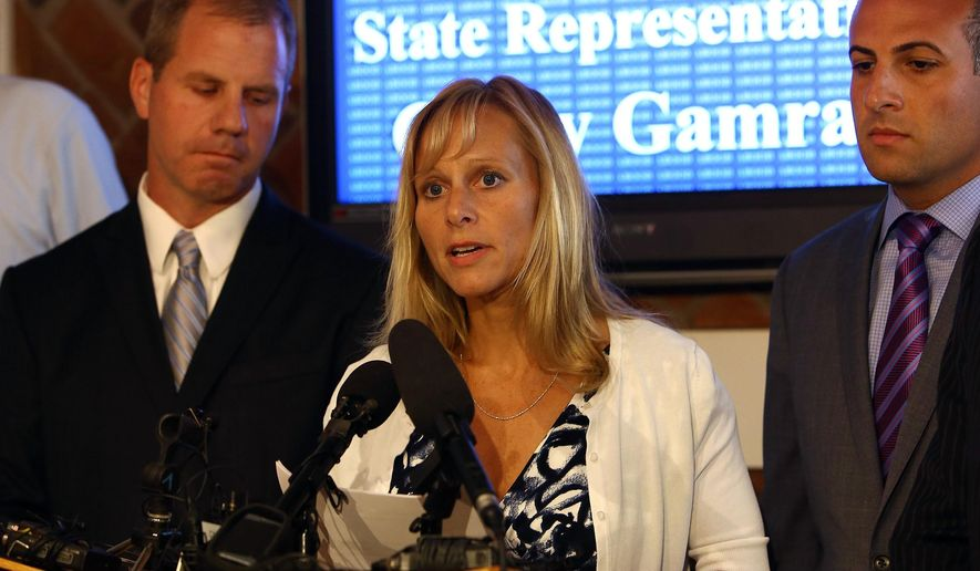 Representative Cindy Gamrat addresses the media with an apology at Abood Law Firm in Lansing, Mich.,  Friday, Aug. 14, 2015. The embattled but apologetic Michigan lawmaker who had an extramarital affair with another married legislator said Friday she will not resign from office for now and denied any role in a bizarre, fictional email sent to deflect attention from their relationship. (Danielle Duval/Jackson Citizen Patriot via AP)