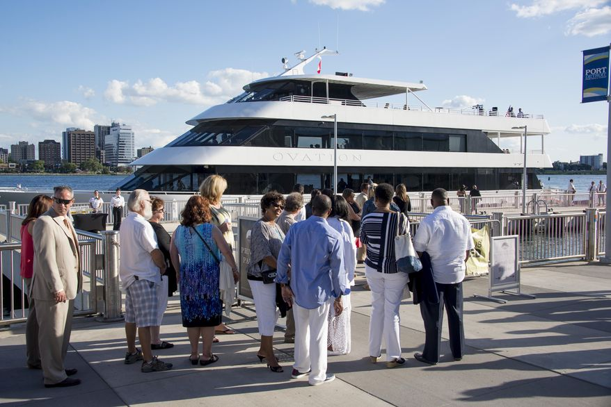 In this photo taken Wednesday, Aug. 12, 2015, party-goers wait to board the Ovation as it sits docked outside the Port Authority dock on Atwater Street in Detroit. A $22 million port development along downtown Detroit's riverfront that aimed to be a stopping point for Great Lakes cruise ships hasn't worked out as planned. The Detroit News reports  that four years after construction of the Detroit/Wayne County Port Authority public dock the facilities are used almost exclusively by a catering company for weddings and other events. Parties also are offered on a yacht. (David Guralnick /Detroit News via AP)  DETROIT FREE PRESS OUT; HUFFINGTON POST OUT; MANDATORY CREDIT