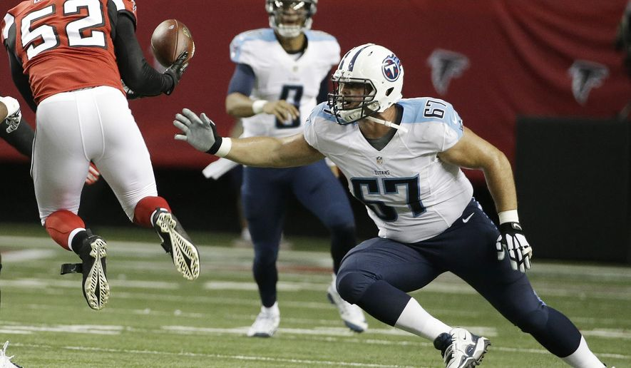 Atlanta Falcons linebacker Justin Durant (52) picks off a Tennessee Titans quarterback Marcus Mariota (8) pass as Tennessee Titans linebacker Justin Staples (57) defends during the first half of an NFL football preseason game , Friday, Aug. 14, 2015, in Atlanta. (AP Photo/David Goldman)