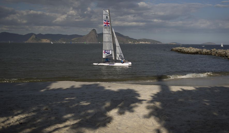 "Nacra 17 class athletes from Great Britain arrive to Flamengo beach practicing one day before the sailing test event ahead of the Rio 2016 Olympic Games in Guanabara Bay in Rio de Janeiro, Brazil, Friday, Aug. 14, 2015. Bruce Gordon, the WHO's coordinator of water, sanitation, hygiene and health, said that testing for viruses ""would be advisable"" given it's known that human sewage pollution is rife in Rio's waters. (AP Photo/Leo Correa)"