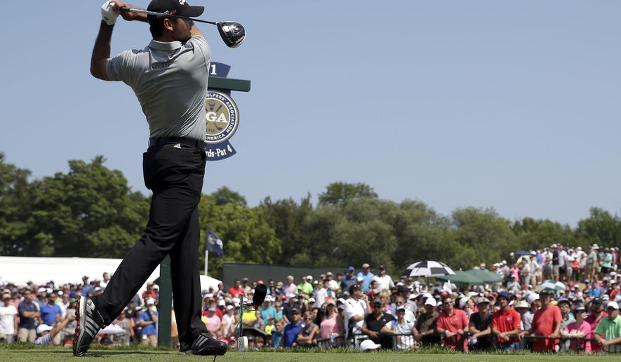 Jason Day, of Australia, hits on the first hole during the second round of the PGA Championship golf tournament Friday, Aug. 14, 2015, at Whistling Straits in Haven, Wis. (AP Photo/Jae Hong)