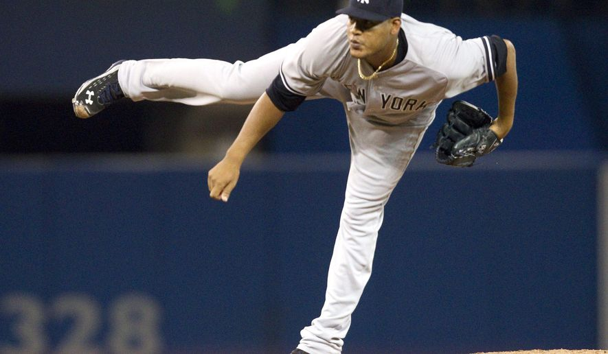 New York Yankees starting pitcher Ivan Nova throws against the Toronto Blue Jays during first inning  baseball action in Toronto on Friday, Aug. 14, 2015. (Fred Thornhill/The Canadian Press via AP)