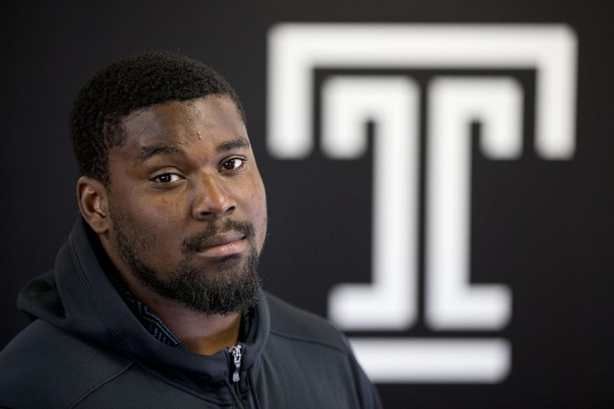 In this Thursday, Aug. 13, 2015, photo, Temple University football player Praise Martin-Oguike poses for a photograph in Philadelphia. The defensive end from Temple lost two years of his college football career after being charged in May 2012 with raping a female student. Not until 18 months had past, after he had been kicked off the team and out of school did, did prosecutors find evidence on the accuser's cell phone supporting Martin-Oguike's claims of innocence. With jury selection for his trial in progress, the charges were dismissed. (AP Photo/Matt Rourke)