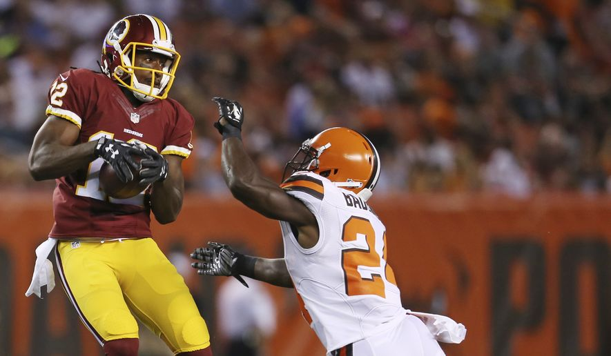 Washington Redskins wide receiver Andre Roberts (12) catches a pass in front of Cleveland Browns cornerback Johnson Bademosi (24) during the second quarter of an NFL preseason football game, Thursday, Aug. 13, 2015, in Cleveland. (AP Photo/Ron Schwane)