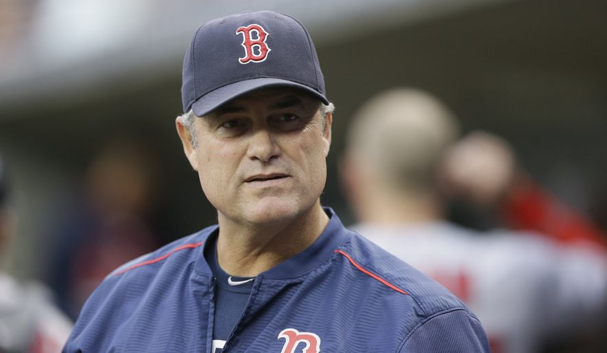 FILE - In this Saturday, Aug. 8, 2015 file photo, Boston Red Sox manager John Farrell watches from the dugout during the first inning of a baseball game against the Detroit Tigers in Detroit. Boston Red Sox manager John Farrell says he has lymphoma and is stepping away from the team, Friday, Aug. 14, 2015.  (AP Photo/Carlos Osorio, File)
