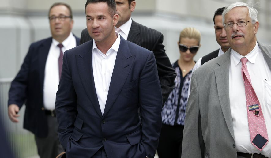 "FILE - In this Wednesday, Sept. 24, 2014 file photo, TV personality Mike ""The Situation"" Sorrentino, left, walks with his lawyer, Richard Sapinski, right, while leaving the MLK Jr. Federal Courthouse in Newark, N.J., after a court appearance in Newark. On Friday, Aug. 14, 2015, a judge gave Sorrentino until mid-October to get a new attorney and declined his request for a court-appointed attorney, after Sapinski withdrew from the federal tax fraud case. (AP Photo/Julio Cortez)"
