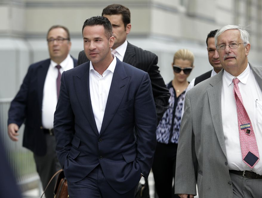 """FILE - In this Wednesday, Sept. 24, 2014 file photo, TV personality Mike """"The Situation"""" Sorrentino, left, walks with his lawyer, Richard Sapinski, right, while leaving the MLK Jr. Federal Courthouse in Newark, N.J., after a court appearance in Newark. On Friday, Aug. 14, 2015, a judge gave Sorrentino until mid-October to get a new attorney and declined his request for a court-appointed attorney, after Sapinski withdrew from the federal tax fraud case. (AP Photo/Julio Cortez)"""