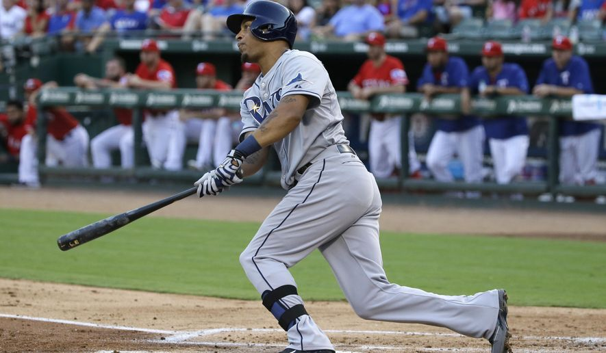 Tampa Bay Rays Desmond Jennings watches his RBI single during the second inning of a baseball game against the Texas Rangers in Arlington, Texas, Friday, Aug. 14, 2015. Rays Asdrubal Cabrera scored on the play. (AP Photo/LM Otero)