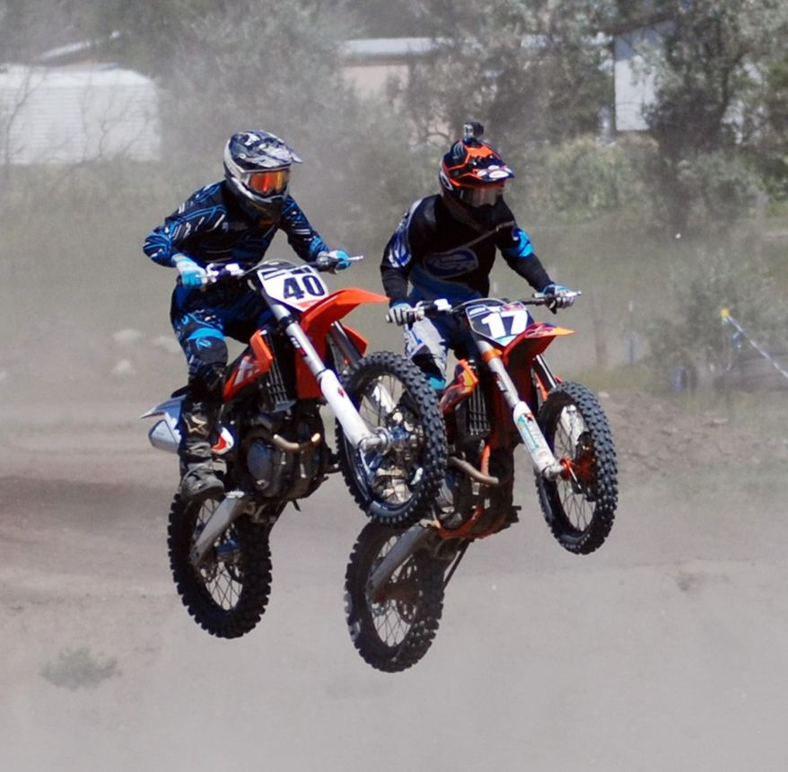 In this Saturday, Aug. 8, 2015 photo, Riders participate in the first annual Kris Barnes Memorial motocross race was held in Ruthville, N.D. Racers from ages 4-57 competed in the eight-hour race day, which honored Kris Barnes, who was killed in an oil-drilling rig accident in March 2014. (John Denega/The Minot Daily News via AP)