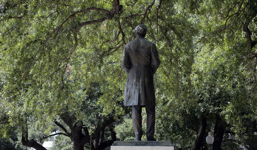 A statue of Jefferson Davis stands on the campus of the University of Texas, Friday, Aug. 14, 2015, in Austin, Texas. The statue of Davis, who was president of the Confederacy during the Civil War, will be removed and placed in the school's Dolph Briscoe Center for American History as part of an educational display. (AP Photo/Eric Gay)