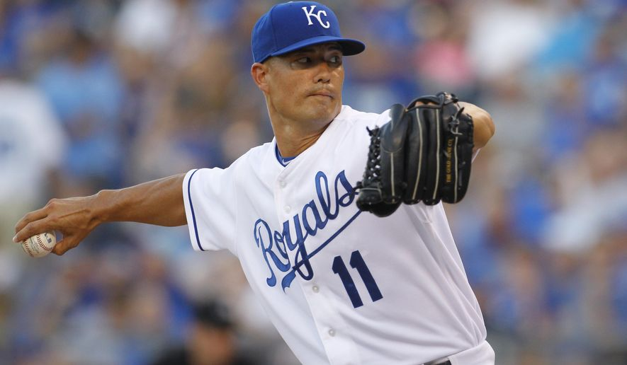 Kansas City Royals pitcher Jeremy Guthrie throws in the first inning of a baseball game against the Los Angeles Angels at Kauffman Stadium in Kansas City, Mo., Thursday, Aug. 13, 2015. (AP Photo/Colin E. Braley)