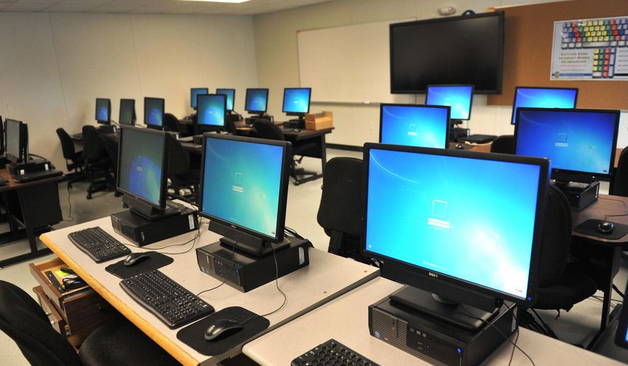 In this photo taken Thursday, Aug. 13, 2015, computers are set up and ready to be used in a portable classroom in Archer City, Texas, that will be used temporarily while the demolition of the old Archer City High School is done to make way for a new school building. (Christopher Walker/Times Record News via AP) ** FILE **