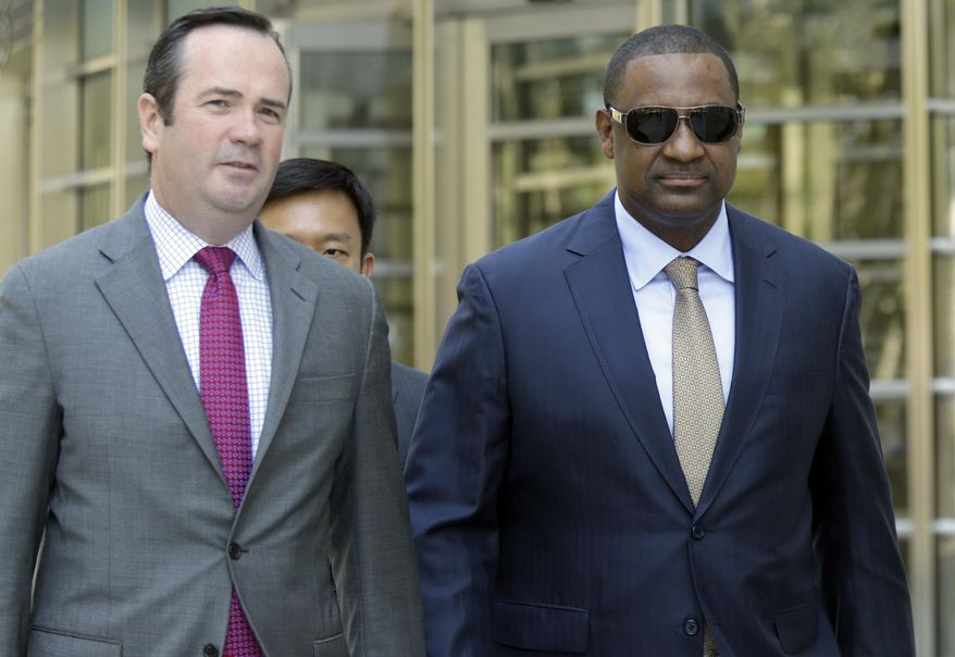 Former FIFA vice president Jeffrey Webb, right, leaves Brooklyn federal court with his attorney Edward O'Callaghan, Friday, Aug. 14, 2015, in New York. Webb is one of 14 people indicted in May in the U.S. Justice Department's investigation into corruption at FIFA. (AP Photo/Mary Altaffer)
