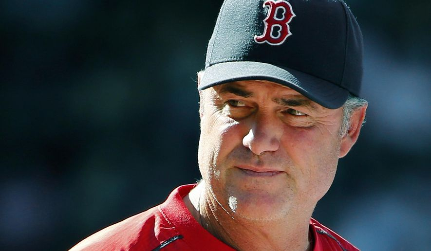 FILE - In this Aug. 2, 2015 file photo, Boston Red Sox manager John Farrell watches action during the eighth inning of a baseball game against the Tampa Bay Rays at Fenway Park in Boston. Farrell said Friday, Aug. 14, 2015, he would take a medical leave for treatment of lymphoma. (AP Photo/Winslow Townson, File)