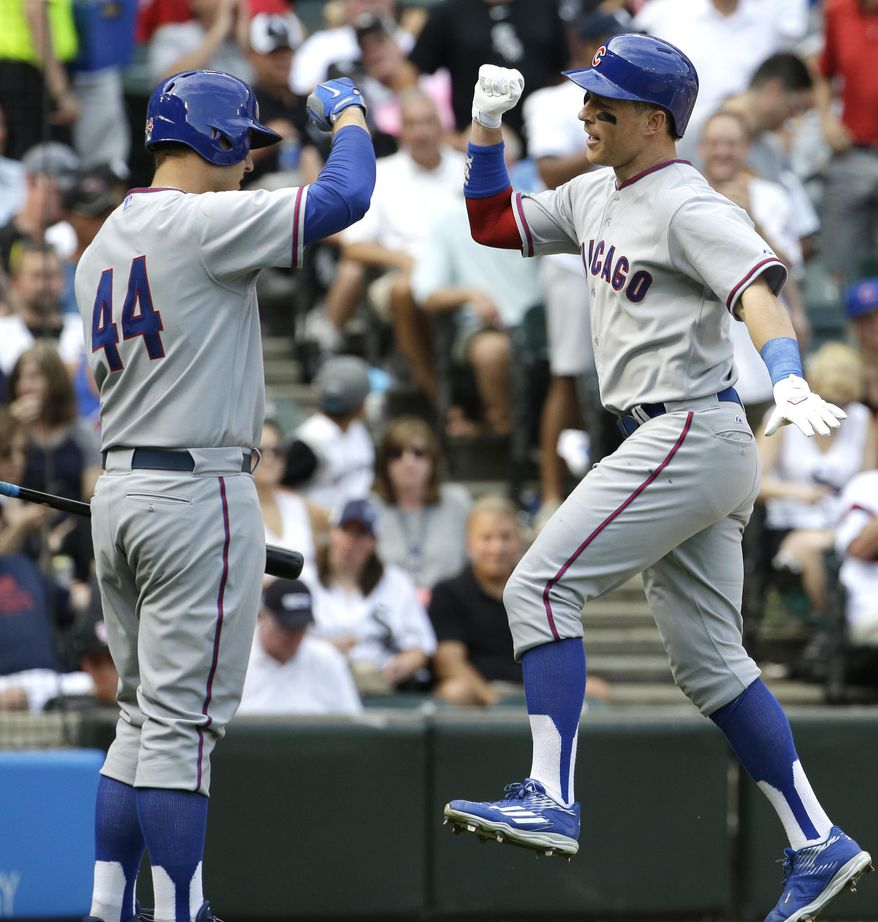 RETRANSMISSION TO CORRECT YEAR - Chicago Cubs' Chris Coghlan, right, celebrates with Anthony Rizzo after hitting a solo home run during the fifth inning of an interleague baseball game against the Chicago White Sox Friday, Aug. 14, 2015,  in Chicago. (AP Photo/Nam Y. Huh)
