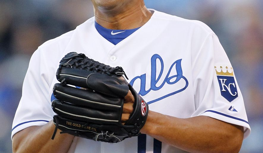 Kansas City Royals pitcher Jeremy Guthrie reacts after walking a batter in the first inning of a baseball game against the Los Angeles Angels at Kauffman Stadium in Kansas City, Mo., Thursday, Aug. 13, 2015. (AP Photo/Colin E. Braley)