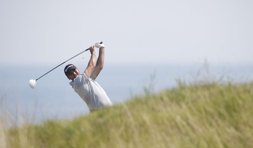 Jason Day, of Australia, hits on the fifth hole during the second round of the PGA Championship golf tournament Friday, Aug. 14, 2015, at Whistling Straits in Haven, Wis. (AP Photo/Jae Hong)